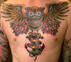 collection of 25 owl and flames tattoos on chest