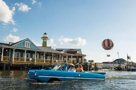 amphibious rv car drives into the lake at downtown disney in walt disney world