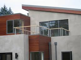 wooden dominated materials of house balcony glass wall design has
