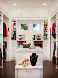 futuristic walk in dressing room design with neat white cabinet