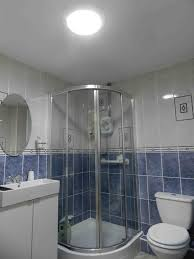 european bathroom designs bathroom design blue and white tile shower tub glass oval mirror