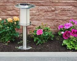 backyard patio swing lamp post stair light mulch patio paver