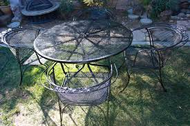 modern vintage wrought iron patio set with rose pink bistro