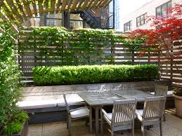 exterior design covered patio with outdoor seating and planter
