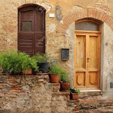 doorsteps decorated with flowerpots to the tuscan house italy