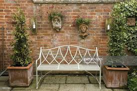 enclosed patio garden with traditionalstyle bench wallmounted