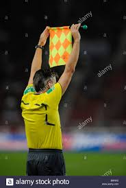 Penalty Flag Football Linesman Showing His Flag Interruption Of The Game For