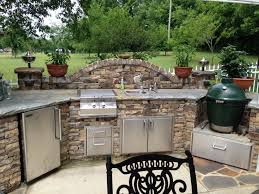 stunning outdoor kitchen with green egg and big custom sandy