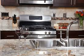 can you change kitchen cabinets and keep granite here s how to clean granite countertops the right way