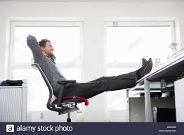 Feet On The Desk Man Sitting On Office Chair With Feet Up On Desk Stock Photo