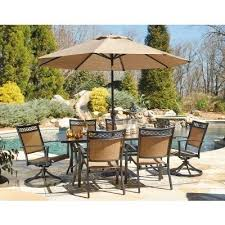 carmadelia outdoor dining set w swivel chairs and umbrella