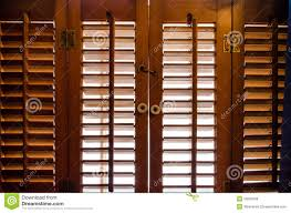 locked wooden window shutters from the inside stock photo image