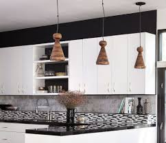 white cabinets and open shelving black solid countertop coopper