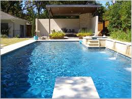 cool pool design inspiration with blue water white lounge chairs