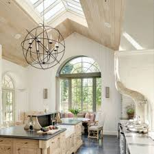 bespoke kitchen design with vaulted ceiling and glass roof and
