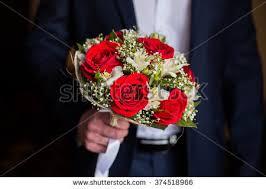 wedding flowers groom wedding flowers groom holds bouquet white stock photo 374518966