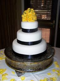 classic white wedding cake with yellow flowers beth ann u0027s
