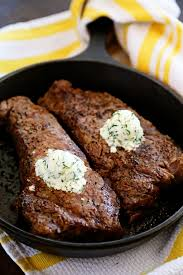 2 cast iron skillet new york strip steaks with gorgonzola cheese