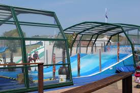 toughened safety glazing in a telescopic swimming pool enclosure