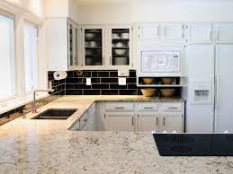 light colored granite countertops glass block kitchen backsplash and light brown granite counter