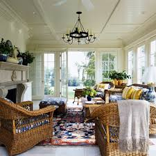 indoor wicker furniture sunroom traditional with beige throw white