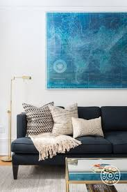 blue sofa and blue map with gold accents in the living room