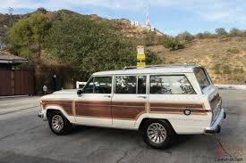 1988 jeep wagoneer jeep grand wagoneer w wood paneling white tan restored v8 woody