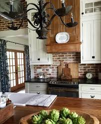 gorgeous kitchen tall ceiling brick wall iron chandelier