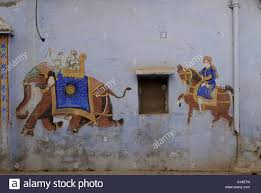 wall mural painting of an elephant and horse on a house wall in stock photo wall mural painting of an elephant and horse on a house wall in bundi rajasthan india