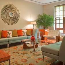 Decorating Ideas On Orange Living Room Color Orange Inspired - Orange living room decorating ideas