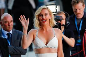charlize theron flashes the flesh in a skimpy bra and mini skirt