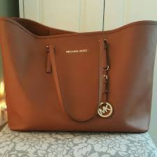 designer taschen outlet michael kors michael kors brown tote offers welcome it s completely real