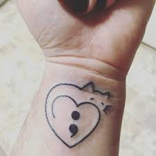 my tattoo simple heart into cat outline with the semicolon for