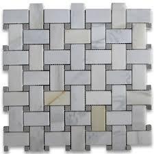 calacatta gold 1x2 basketweave mosaic tile w gray dots honed