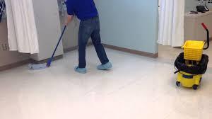 waxing a floor traditional mop
