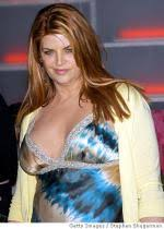 Kirstie Alley shows fuller figure as she parks outside vegan     Complex