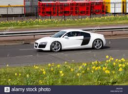 Audi R8 White - a white audi r8 mid engine 2 seater super sports car travelling