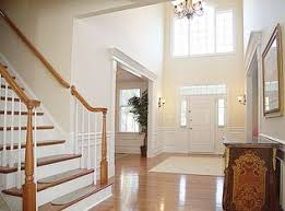 traditional hallway with hardwood floors wainscoting in raleigh