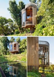 this curvaceous wooden house sits among the trees contemporist