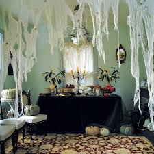 interior house decor for halloween in bedroom with black hanging house decor for halloween indoor using white hanging drapes as spider web and scary pumpkins