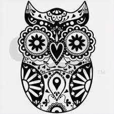 unique skull inside the owl is fantastic tattoos