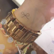 small bow on wrist
