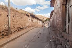 adobe houses street with traditional adobe houses in maras village peru stock