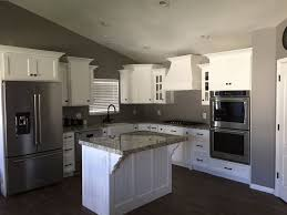 gray kitchen walls with white cabinets grey walls with white kitchen cabinets and rubbed bronze
