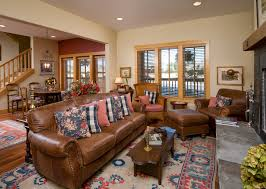 light brown leather couch living room traditional with area rug