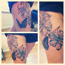 hibiscus butterfly on thigh tattooshunt com