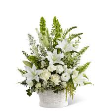 saint thomas more catholic church flower arrangements baskets