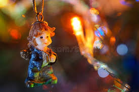 miniature christmas tree lights a miniature ornamental figurine on a christmas tree stock image