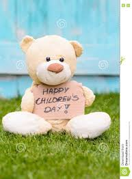 s day teddy teddy holding cardboard with information happy children s day