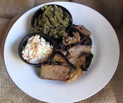 smoked brisket platter with homemade cole slaw and southern green
